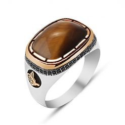 Ala Collection for gentlemen. Brown Tiger's Eye Men Ring made by 925 sterling silver. Tiger's Eye stone used on ring with gold color rhodium plated frame. Used 1 line small marcasite stones for ornament. At sides used gold color rhodium plated tughra sign on black base. Made in Istanbul, Turkey.