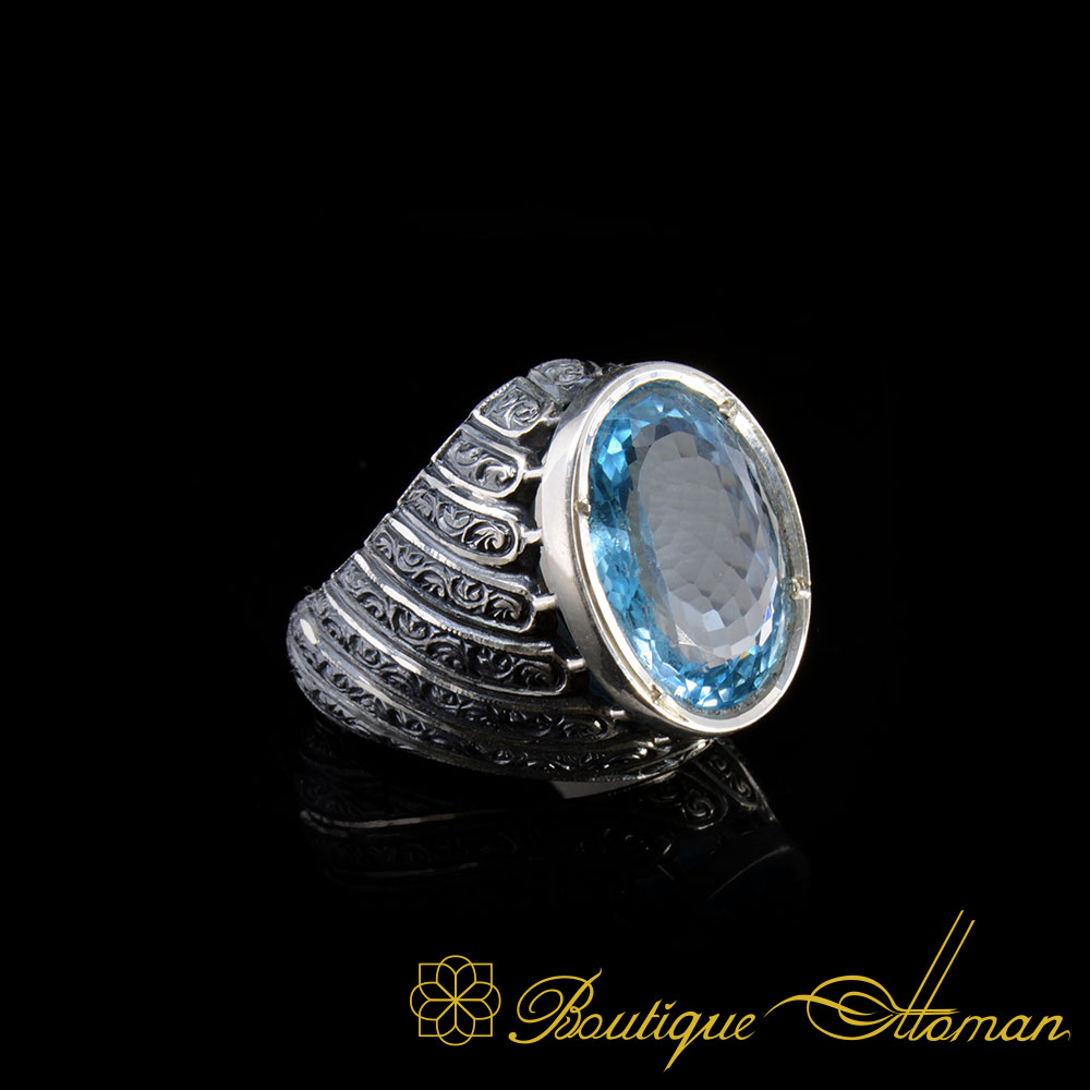 From Boutique Ottoman Exclusive One of A Kind Collection. Made with 925 Sterling silver by hand with blue aquamarine stone. Sides are specially engraved by hand.  Material: 925 Sterling Silver Stone Type: Aquamarine Made in Istanbul, Turkey by Boutique Ottoman Jewelers. Special limited edition product. One piece only!